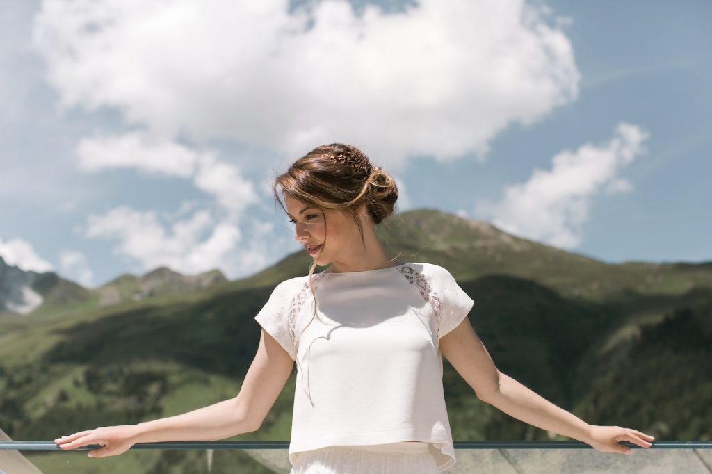 Bride looking at the mountains in Switzerland