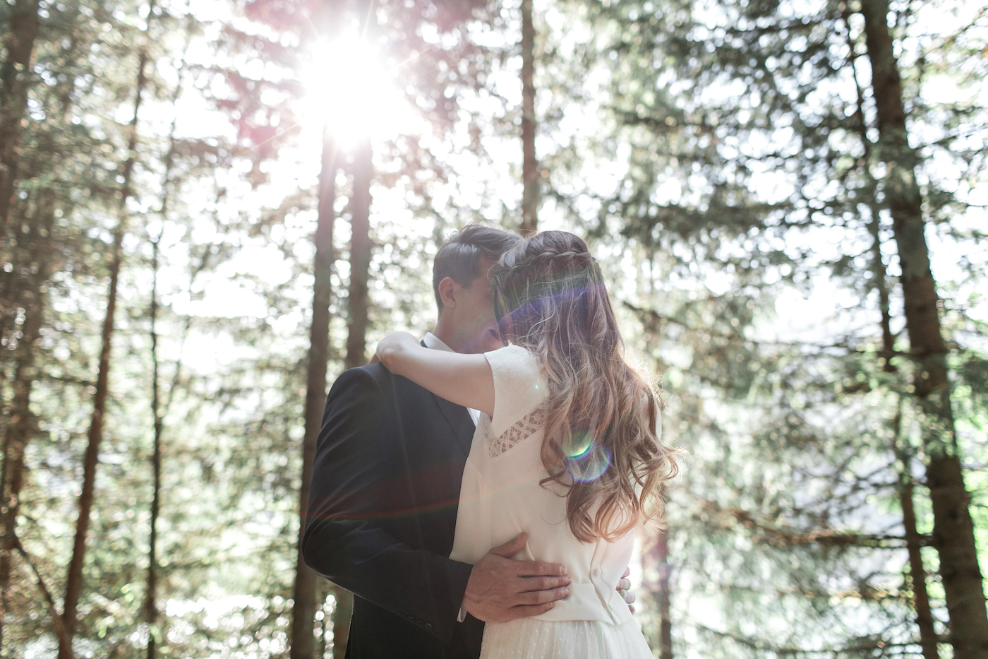 Adventurous bride and groom hugging in the Swiss Alps styled by international wedding planner Elisabetta White