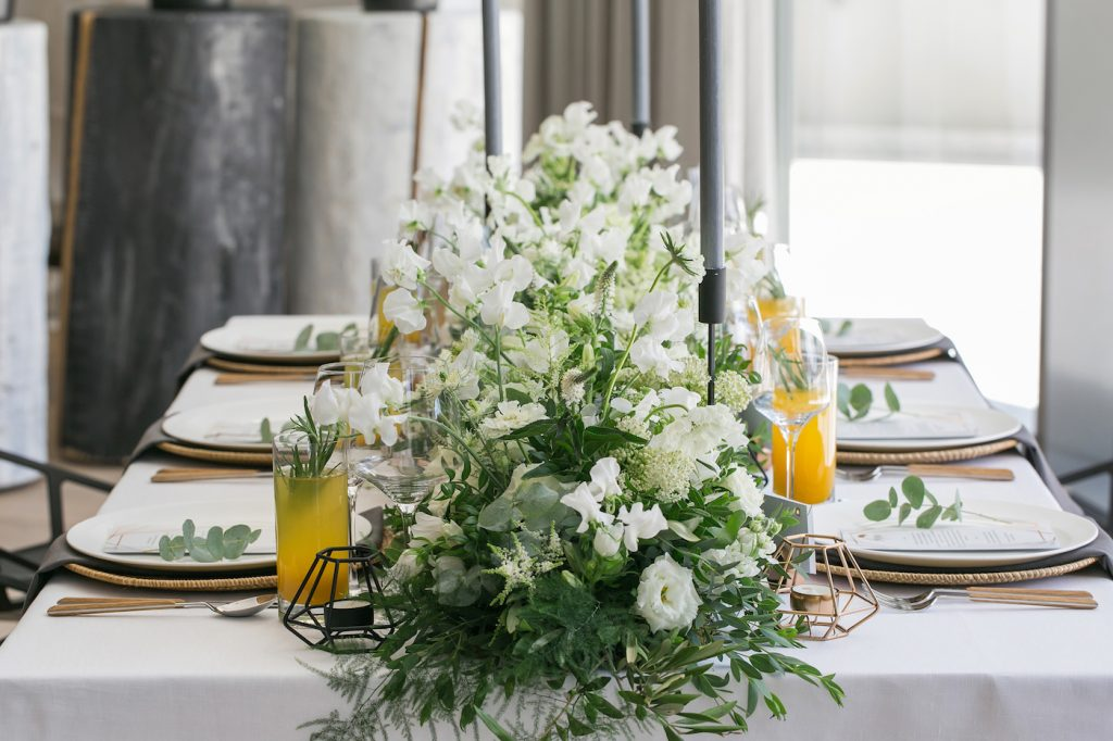 Foliage and white flower table runner for a wedding at Intercontinental Davos styled by international wedding planner Elisabetta White