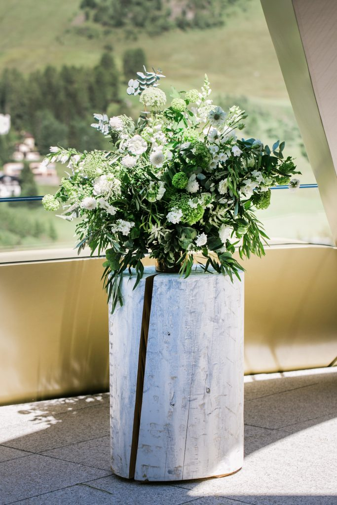 White wooden stop with lush flower arrangements by Willowgold styled by international wedding planner Elisabetta White