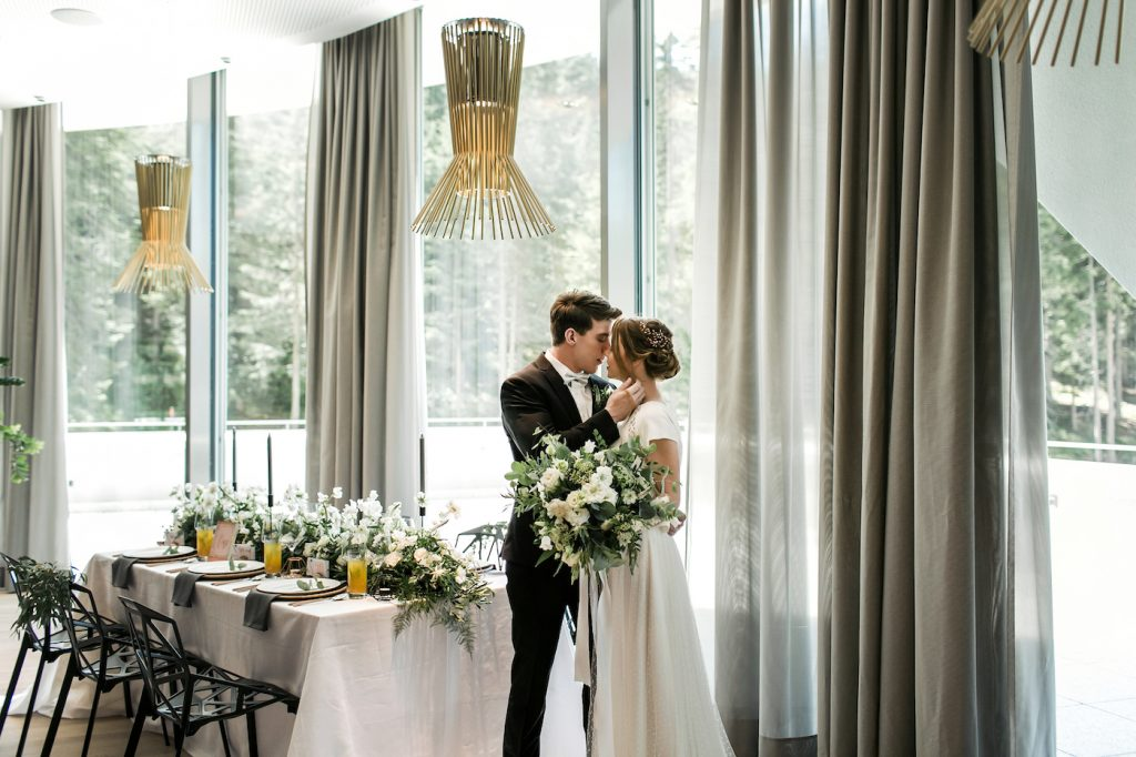 Bride and groom by their wedding table at Intercontinental Davos Hotel