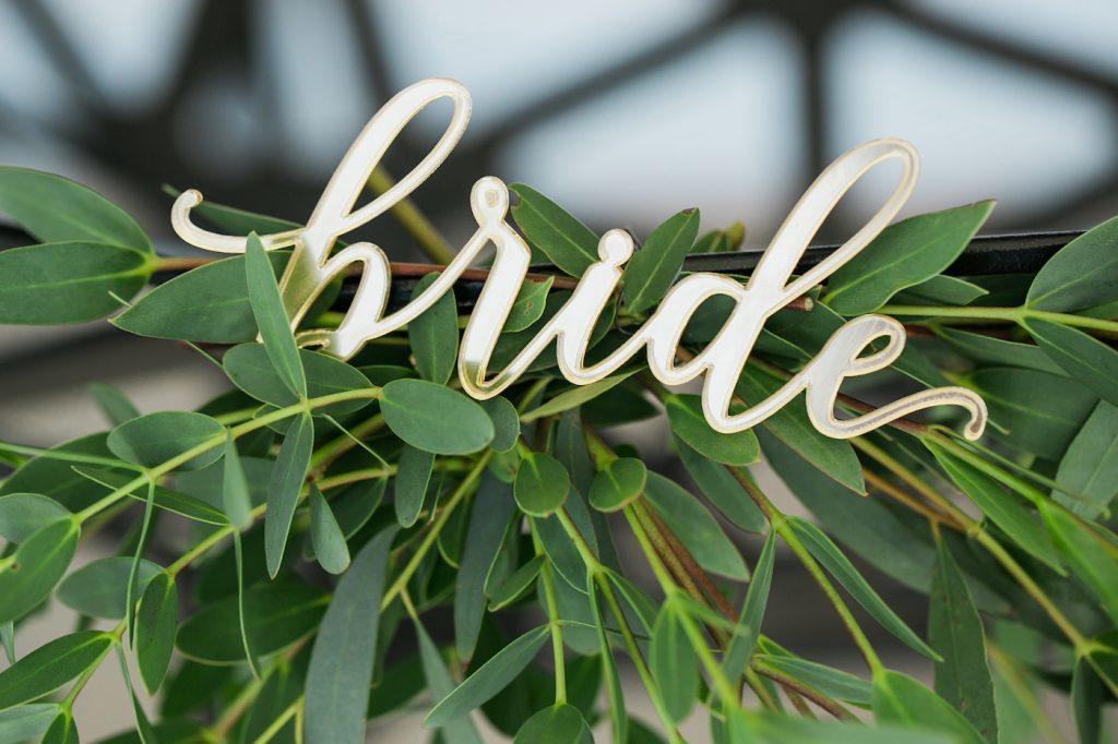 Laser cut gold bride signage for wedding styled by international wedding planner Elisabetta White